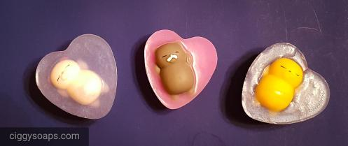 Kitty cat squishies swimming in shimmery heart soaps